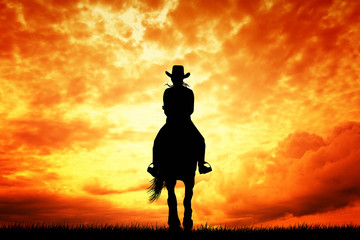 Girl on horseback at sunset