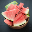 Plate with watermelon cut into slices, studio shot