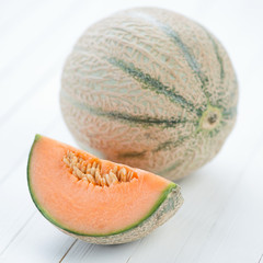 Ripe cantaloupe and its slice, close-up