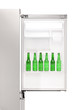 Close up of an open refrigerator full of beer bottles
