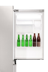 Close up of an open fridge full of beer bottles