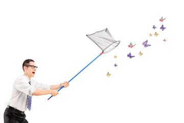 Man catching butterflies with net