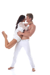 Beautiful smiling couple dancing in studio