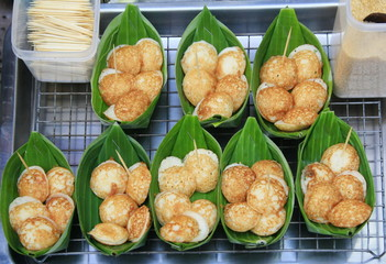 Coconut milk mix with powder fried dessert in banana leave,thai