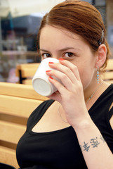Young woman portrait drinking coffee