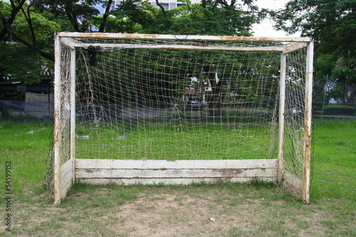Old soccer goal in field
