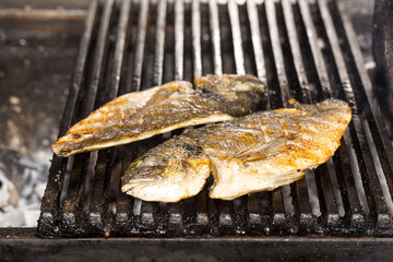 cooking fish on the grill in the restaurant