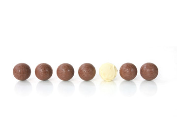 To be different - a white chocolate among a row of brown ones