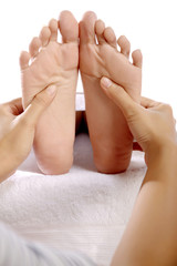Giving massage to bare foot