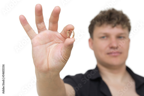 man holding a gold ring on a white background
