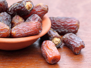 Fresh Arabian Dates on a clay pot