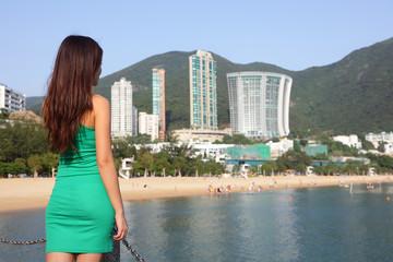 Hong Kong tourist woman at Repulse Bay beach