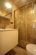 Shower with glass sliding door
