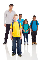 boy standing in front of classmates and teacher