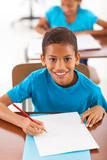 Fototapety african schoolboy writing classwork