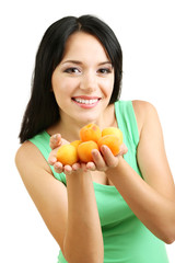 Girl with fresh apricots isolated on white