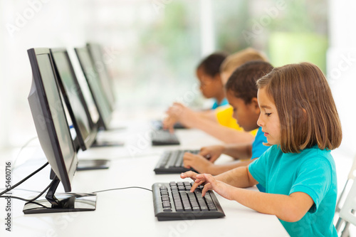 elementary school students in computer class - 54610716