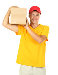 Young delivery man holding parcel, isolated on white