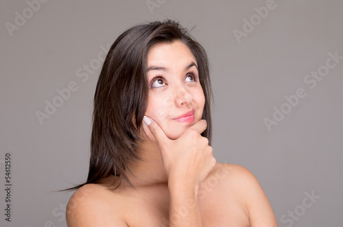 Thinking naked topless woman