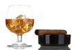 Brandy glass with ice and cigar isolated on white