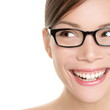 Woman wearing glasses looking happy to side