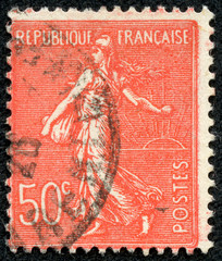 stamp printed in France shows sowing woman