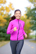 Running sport woman training in fall autumn forest