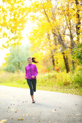 Autumn lifestyle woman running in fall forest