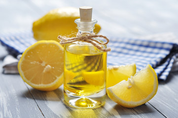 lemon oil in a glass bottle