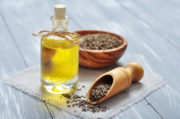 cumin oil in a glass bottle