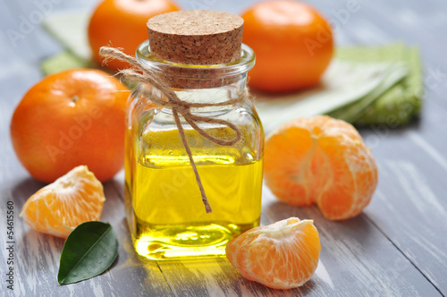 tangerine oil in a glass bottle