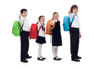 Back to school concept with happy kids giving thumbs up sign