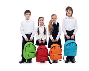 Group of happy kids with schoolbags - back to school concept