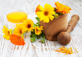 Calendula flowers and mortar