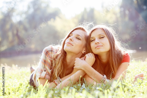 two women on grass