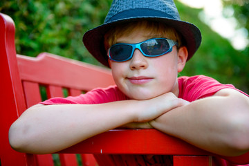 boy with hat and sunglasses