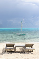 Two vacancy deck chairs in paradise