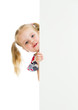kid girl looking out of blank advertising banner
