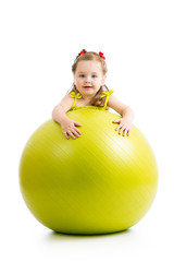 Child girl having fun with  gymnastic ball isolated