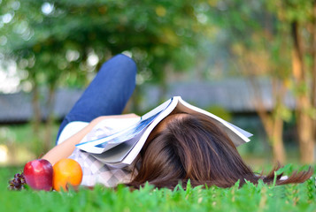 women student is sleeping with book