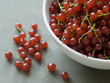 Red currants in a white bowl