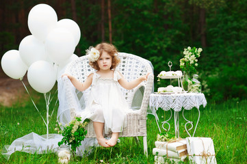 Beautiful little girl in white decorations