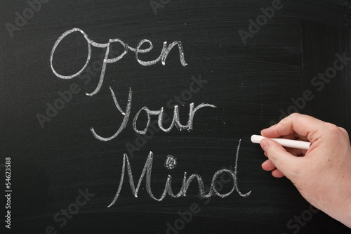 Writing Open Your Mind on a blackboard