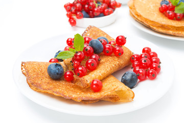 crepes with fresh berries for breakfast, isolated