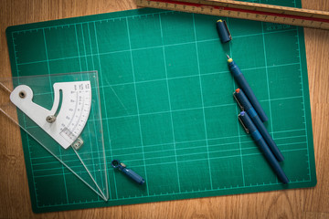 Cutting mats , Pen drawings , adjust angle tool , scale ruler  o