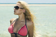Beautiful blond woman in sunglasses on beach.paradise island