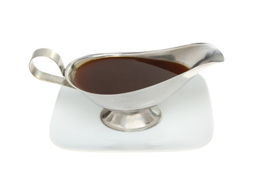 Gravy boat on a plate
