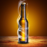 Beer Bottle with chill smoke on wood table