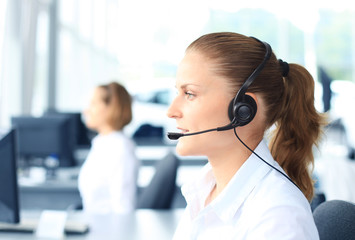 Beautiful young female call center operator with headset
