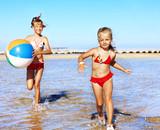 Children  running on  beach.